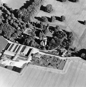 Oblique aerial view centred on the castle, steading and farmhouse, taken from the WNW.