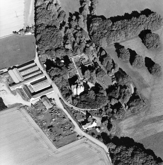 Oblique aerial view centred on the castle, steading and farmhouse, taken from the WSW.