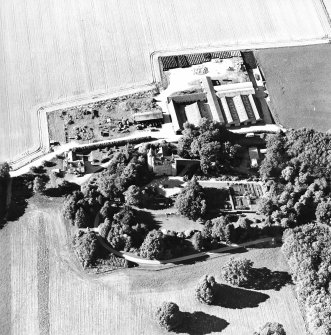 Oblique aerial view centred on the castle, steading and farmhouse, taken from the SSE.