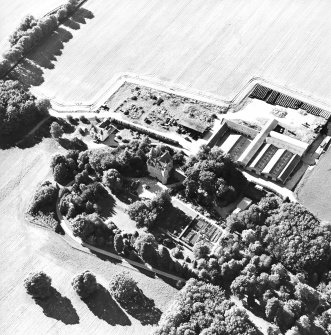 Oblique aerial view centred on the castle, steading and farmhouse, taken from the ESE.
