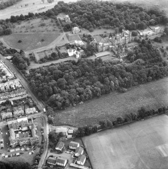 Oblique aerial view centred on Craig House, Old Craig House, South Craig Villa, Bevan House, East Craig and Queen's Craig