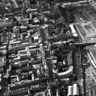 Aerial view showing Canongate at bottom of photograph, Cowgate to left, Lawnmarket at top and Waverley Station to right
