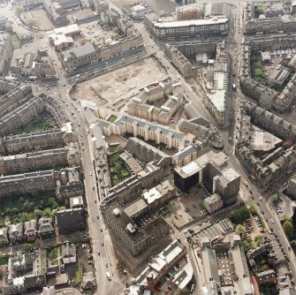 Oblique aerial view of Edinburgh centred on the Inland Revenue offices, Lauriston Place, taken from the E.