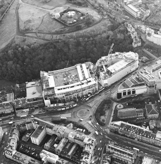 Oblique aerial view centred on the redevelopment of Greenside Place with the observatory and cathedral adjacent, taken from the NW.