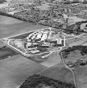 Oblique aerial view centred on the hospital under construction, taken from the NNE.