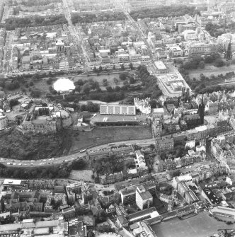 Aerial view of centre of Edinburgh including Princes Street and New Town at top of photograph, Lawnmarket to right, Grassmarket at bottom and The Castle at left