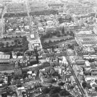 Aerial view of centre of Edinburgh including Princes Street and the New Town at top of photograph, Waverley Station and St Giles on right, Candlemaker Row at bottom and Castle Esplanade at left