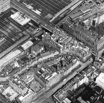 Oblique aerial view centred on the Scotsman buildings, taken from the SW.