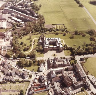 Aerial view showing Holyrood Palace and Abbey in their grounds, plus parts of Canongate, Holyrood Road and Abbeyhill