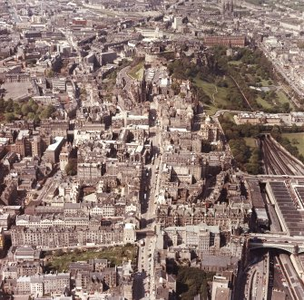 Aerial view of centre of Edinburgh with the High Street running top to bottom across photograph and North and South Bridges running left to right.