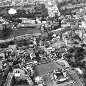 Aerial view of centre of Edinburgh including Princes Street at top of photograph, George IV Bridge at right, George Heriot's School at bottom, and The Castle at left