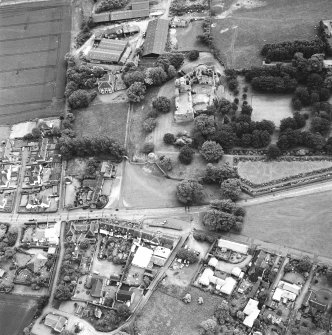Dirleton Castle, oblique aerial view, taken from the NNW. The cropmark of a possible building is visible on Dirleton Village Green in the foreground.