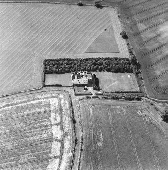 Obique aerial photograph centred on Falside Castle, taken from the NE.