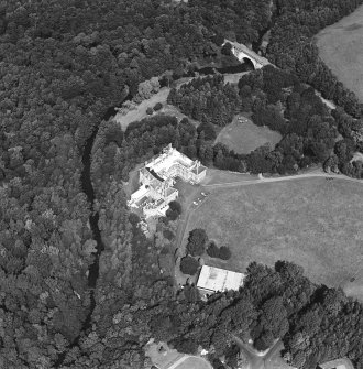 Oblique aerial view centred on the country house and garden with bridge adjacent, taken from the SSE.