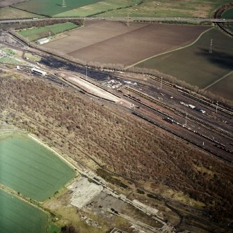 Oblique aerial view centred on the railway marshalling yard, taken from the SW.
