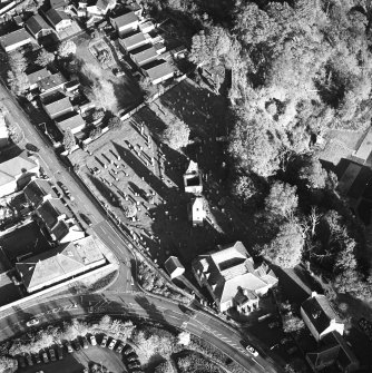 Oblique aerial view of Penicuik, ST Kentigern's Church and Churchyard centred on a church churchyard, and burial ground, with a mausoleum, other church and hearse house adjacent, taken from the W.