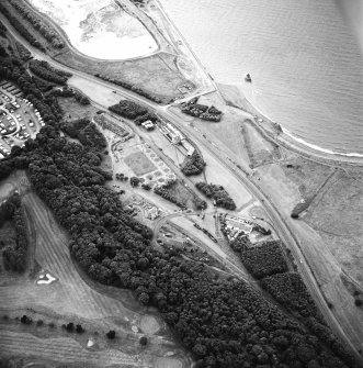 Oblique aerial view centred on the museum and remains of the coal mine, brick-works, tile-works and harbour, taken from the ESE.