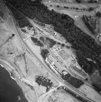 Oblique aerial view centred on the museum and remains of the coal mine, brick-works, tile-works and harbour, taken from the WNW.
