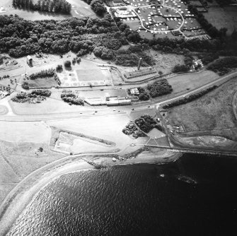 Oblique aerial view centred on the museum and the remains of the coal mine, brick and tileworks and harbour, taken from the NNW.