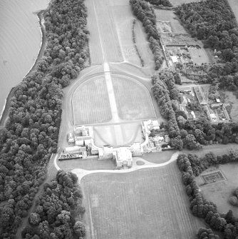 Oblique aerial view centred on the house, taken from the W.