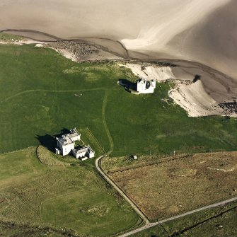 Oblique aerial view of Breachacha centred on Breachacha House and a castle, taken from the W.