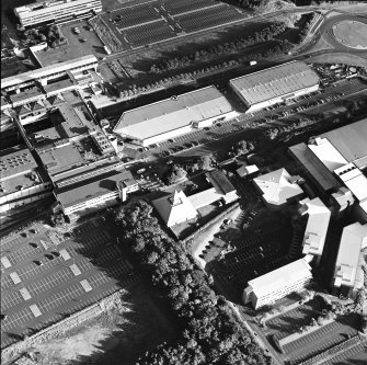 Oblique aerial view of Cumbernauld centred on St Mungo's Church in the town centre, taken from the NNW and recorded as part of the World of Worship project.