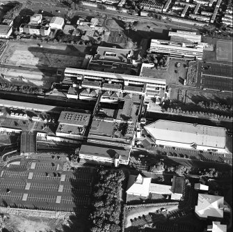Oblique aerial view of Cumbernauld centred on St Mungo's Church in the town centre, taken from the NW and recorded as part of the World of Worship project.