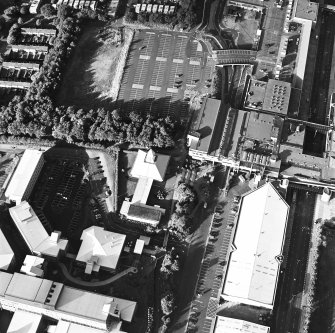 Oblique aerial view of Cumbernauld centred on St Mungo's Church in the town centre, taken from the SW and recorded as part of the World of Worship project.
