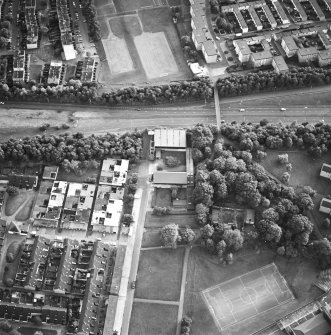Oblique aerial view of Cumbernauld centred on Kildrum Parish Church, taken from the SW and recorded as part of the World of Worship project.