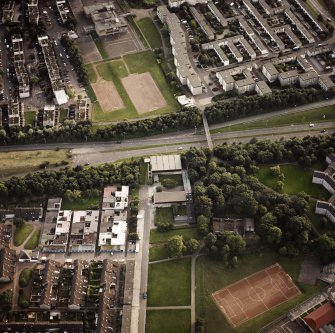 Oblique aerial view of Cumbernauld centred on Kildrum Parish Church, taken from the NE and recorded as part of the World of Worship project.
