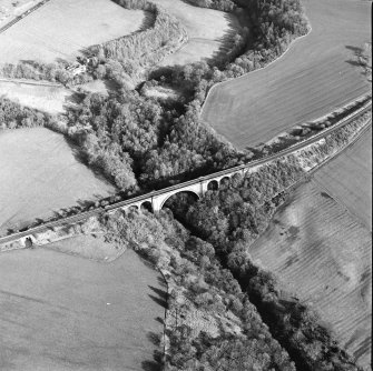 Oblique aerial view centred on the railway viaduct, taken from the W.