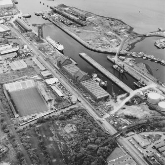 Greenock, James Watt Dock, oblique aerial view, taken from the S. Cappielow is visible in the left centre of the photograph.