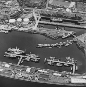 Greenock, James Watt Dock, oblique aerial view, taken from the NNE. Cappielow is visible at the top edge of the photograph.