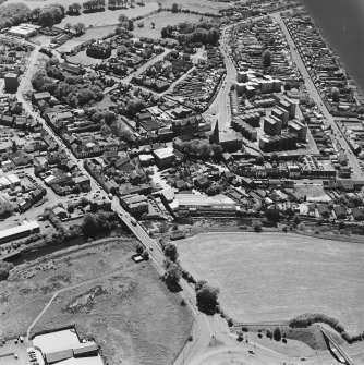 Aerial view of Galston road bridge and Church Lane Lace Mill, including Barr Castle, taken from NE.