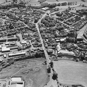 Aerial view of Galston road bridge, Church Lane Lace Mill, Barrmill Road Lace Factory, Barr Castle, and Bentinck Street Church, taken from NNE.