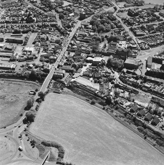 Aerial view of Galston road bridge, Church Lane Lace Mill, Barr Castle, and Bentinck Street Church, taken from NNE.