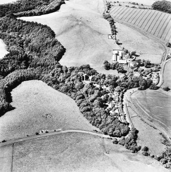 Oblique aerial view, taken from the South-West, centred on the tower-house.