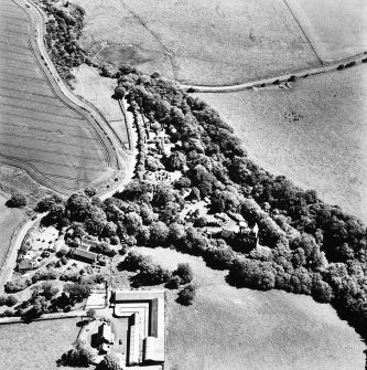 Oblique aerial view, taken from the North-West, centred on the tower-house.