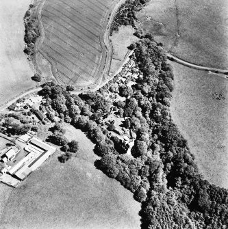 Oblique aerial view, taken from the West, centred on the tower-house.