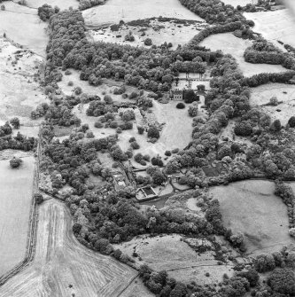 Formakin, oblique aerial view, taken from the SSE, centred on Formakin House. Formakin Mill is visible in the foreground.