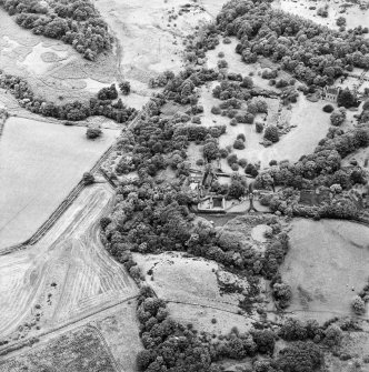 Formakin, oblique aerial view, taken from the ESE, centred on Formakin Mill. Formakin House is visible in the top right-hand corner of the photograph.