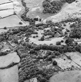 Formakin, oblique aerial view, taken from the ENE, showing Formakin Mill, and out-buildings and the gateway of Formakin House in the centre left of the photograph, and Formakin House in the centre right.