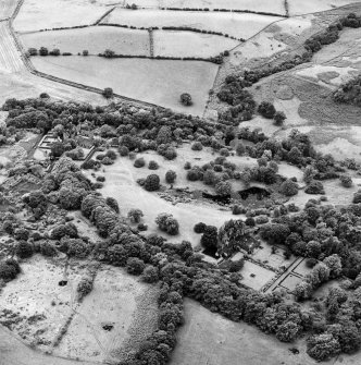 Formakin, oblique aerial view, taken from the NE, showing Formakin House in the bottom right-hand corner of the photograph, and Formakin Mill in the centre left.