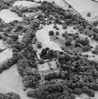 Formakin, oblique aerial view, taken from the NNW, centred on Formakin House. Formakin Mill and out-buildings of Formakin House are visible in the top centre of the photograph.