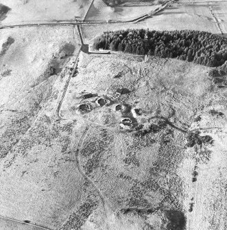 Oblique aerial view centred on the remains of the anti-aircraft battery with traces of the camp adjacent, taken from the ESE.