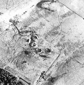 Oblique aerial view centred on the remains of the anti-aircraft battery with traces of the camp adjacent, taken from the W.