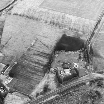 Oblique aerial view centred on the remains of an anti-aircraft battery, taken from the WSW.