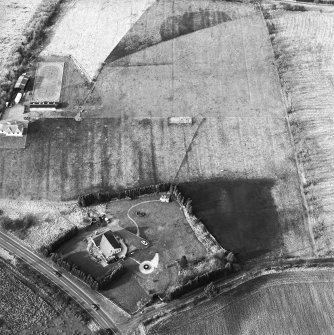 Oblique aerial view centred on the remains of an anti-aircraft battery, taken from the S.