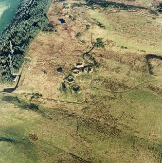 Oblique aerial view centred on the remains of the anti-aircraft battery with traces of the camp adjacent, taken from the SSW.