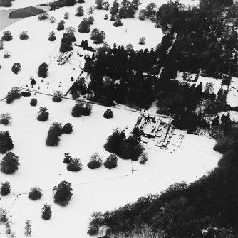 Abercairny House, oblique aerial view, taken from the ESE, centred on the stable block and East walled garden.